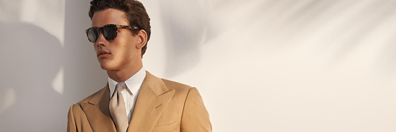 Man in khaki sport coat, beige tie & white dress shirt