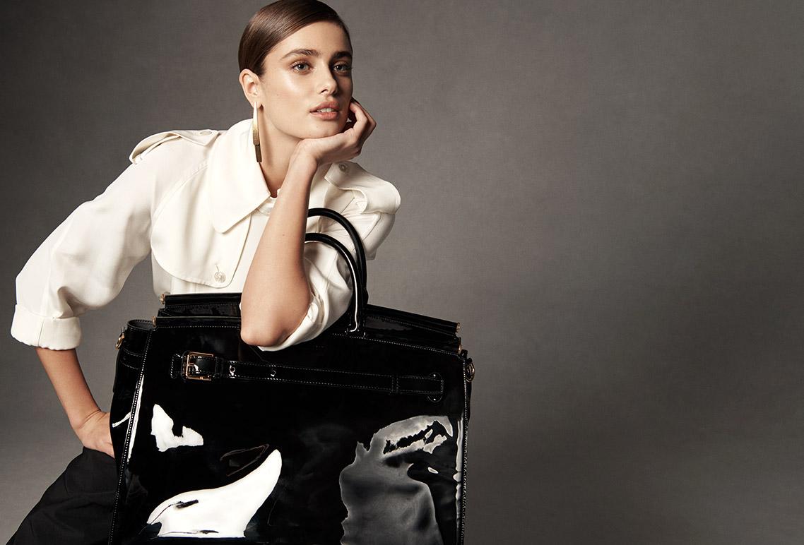 Model carries brown leather RL50 bag.