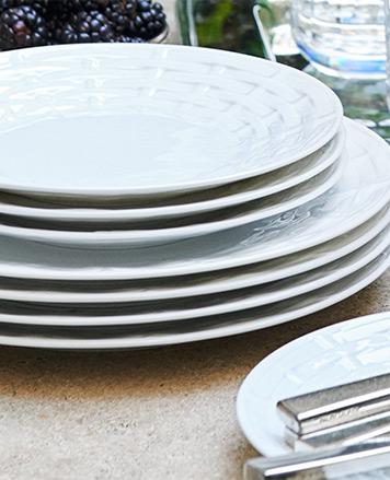 White plates with a tonal basket-weave motif