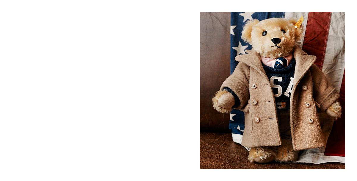 Polo Bear wearing tan coat and navy USA sweater