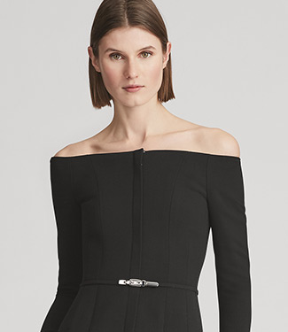 Woman in off-the-shoulder black top